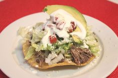 A crispy flat tortilla topped with endless possibilities, anything can go in a tostada, from shredded chicken, beef, shrimp, fish, avocados, veggies, well...the sky's the limit. What are you waiting for? Check the recipe.
