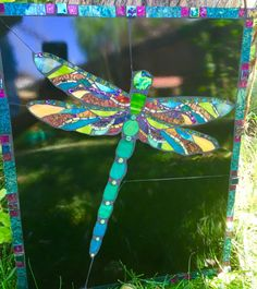We had a lot of dragonflies in Colorado last year which inspired this brillliant colorful dragonfly mosaic using stained glass, irridized glass, VanGogh glass, dichroic glass, millfiori, fused glass and tiles. Set on plywood, it easily hangs on a wall at 6 1/2 lbs. It is 16.5x 19.5 in.