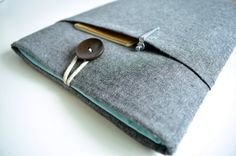 7.9, 9.7, 12.9 Apple iPad Sleeve Custom sizes available. Made to order iPad case can be fit to the iPad Mini, iPad, iPad Air, and iPad Pro with or without a keyboard or smart cover. A charcoal linen fabric cover with front pocket. 6mm thick foam padding keeps your iPad / tablet secured. Lining contrast in aqua cotton fabric and the case is closed by linen string and wood button.  Custom sized for use with existing cases and keyboard covers or folios. For custom sizes, please be sure to note…