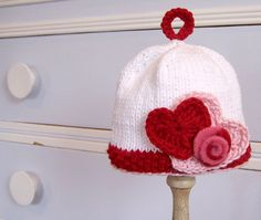 Knit Valentine Hearts and Roses Baby. But it can be a crochet hat : )