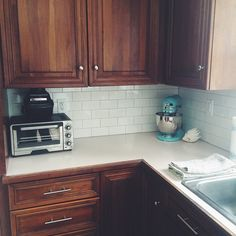 Cherry kitchen cabinets, #white subway tile backsplash