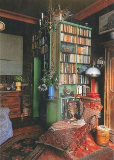 Bohemian library (a little corner closet that *is* bookshelves, inside and out)[=