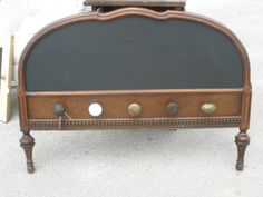 old headboard and door knobs repurposed into a coat rack, with chalkboard paint for messages