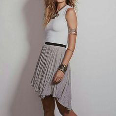Free People Last Chance Asymmetrical Hem knit skt NWT.Draped jersey with raw hem and exposed waist.Undone pleats for movements.Pull on skirt.95rayon&5%spandex.Sold at all fine retailers.Sold out on FP.Retails at 78$$ Free People Skirts Mini