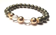 New womans bracelet 8mm pyrite with gold beads and clear quartz