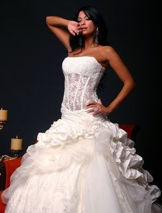 Pnina Tornai ~ I love this dress but with fabric behind the corset. It looks much more sophisticated and elegant