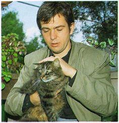 Peter Gabriel pets his cat.