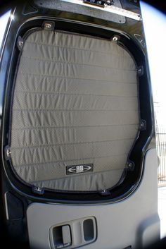 Sprinter Van Rear Door Window Shade. Would be easy enough to DIY with some strong magnets and instead of tabs, just have a border within the window frame to make sure light is blocked.