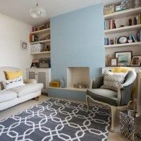 Traditional living room with blue walls and alcove shelving