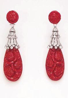 A PAIR OF CORAL AND DIAMOND EAR PENDANTS, BY CODOGNATO**  Each suspending a drop-shaped carved coral pendant of rose motif, by an articulated, three-tiered circular-cut diamond cap, enhanced by diamond collet fringe terminals, to a carved coral rose bloom surmount of circular outline, mounted in 18k white gold Signed Codognato