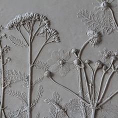 Rachel Dein method of plaster casting captures flowers and foliage in a unique and delicate way. She creates her original casts by making an impression in wet clay and then pouring plaster directly over it. The clay captures the most intricate details, subtly accenting the plaster as it sets. Each clay mould can only be used once, making every piece unique. Casts are then finished and refined by hand; some finished tiles are also hand painted.ceramica