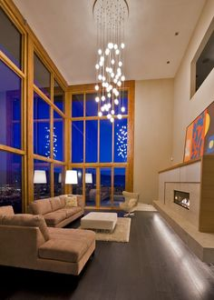 need I say more about these gorgeous windows?  love the sofa's! they actually look comfy for a modern style. =)