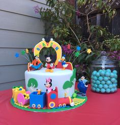 A Mickey Mouse Clubhouse theme, complete with edible train full of candy.  Vanilla cake with Oreo Buttercream filling.