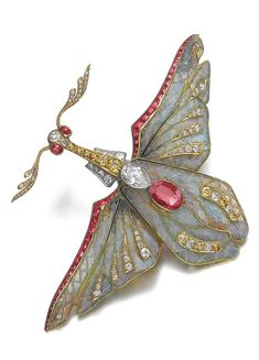 Winged Insect Brooch: ruby, diamond, plique-à-jour enamel, by Philippe Wolfers, circa 1900.