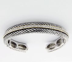This is an absolutely gorgeous 925 Sterling Silver Bangle Bracelet with CZs surrounded by double lines of 14K gold.  This bracelet is inspired by David Yurman.  Weights 40 gram.