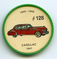 Jello-O Coin 128 - Cadillac (1941) - A rare feature of the 1941 Cadillac was the chrome trim around the windows. The fender Contour followed through to the door, and the basket-weave grille was low and wide in comparison with other makes of the day. All models were equipped with V-8 engines, the V-12 and V-l6 engines being discontinued earlier.