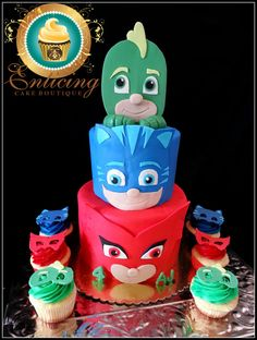 Pj Masks Cake This 3 tier Disney Jr. inspired PJ Masks cake was all in 2D fondant. A few cupcakes were made to accompany the design....