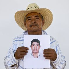 This is @dariolopezm a staff #photojournalist with the AP based in Mexico City posting an #instagram #takeover on @ap.images of my photo essay about Mexicos Other Disappeared.  In this May 12 2015 photo Cirenio Ocampo de Jesus holds up a photo of his son Adolfo Ocampo Marino in Iguala Mexico. His son a mason was 35 years old when he was taken by armed men while working with his father on July 3 2014. #APPhoto by @dariolopezm  Today marks the one-year anniversary of the disappearance of 43…