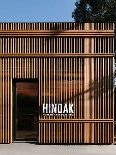 A Vertical Wood Exterior Is the Face Of This New Korean BBQ Restaurant is part of - Australian architecture and interiors firm Biasol, have recently completed HINOAK, a modern Korean BBQ restaurant in Melbourne Retail Facade, Shop Facade, Building Facade, Building Design, Restaurant Exterior Design, Restaurant Facade, Exterior Signage, Restaurant Barbecue, Exterior Shutters
