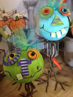 Interiors by Jacquelyn painted her pumpkins in vibrant blue and green to bring her whimsical pumpkin faces to life. What a great idea!!!!