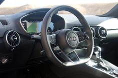 The new TT comes with Audi's virtual cockpit, an all-digital readout that gives you access to all elements of the car from the driver's seat. But first, let's talk about the most important part — this steering wheel.