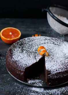 Nigella Lawson's Flourless Chocolate Orange Cake (orange, Hazelnut flour & chocolate all mixed in a blender ) Flourless Chocolate Cakes, Chocolate Desserts, Nigella Lawson Orange Chocolate Cake, Chocolate Almond Cake, Gluten Free Chocolate Cake, Chocolate Orange Cakes, Dense Chocolate Cake Recipe, Flourless Orange Cake, Chocolate Glaze
