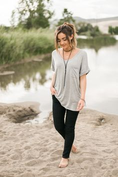 Gray v neck, oversized tee with a pocket!  Model is 5'7'' wearing size Small