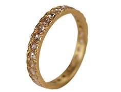 This delicate 2mm pave band by Me & Ro is set with rose cut diamonds and is absolutely stunning