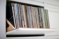 tilt out LPs. love how the 'handle' is designed into the door panel. LP Storage Cabinet 4