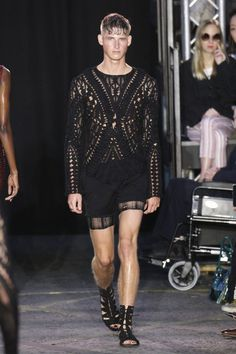Pin for Later: Julien Macdonald Proves a Man Is a Woman's Best Accessory The guys looked seductive, too In knitted, see-through combinations . . .