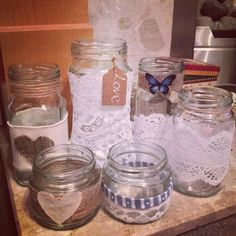 Rustic jars for my Cath Kidston/Rustic wedding. Twine, material, lace, beads