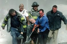 The man in the chair is Father Mychal Judge, FDNY chaplain, who was killed by falling debris as he knelt to pray over a firefighter who was killed by a falling body.  He was the first victim, put in body bag #0001.  NEVER FORGET.