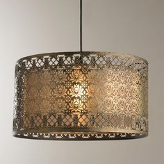 Filigree Lotus Metal Shade Pendant With a vintage bohemian look, this aged brass finish lotus filigree design metal shade surrounds a gold sheer organza drum shade providing a feminine touch that will fit right in with eclectic, traditional, and whims Large Pendant Lighting, Drum Pendant, Pendant Chandelier, Crystal Pendant, Brass Pendant, Pendant Lights, Drum Lighting, Leaf Pendant, Metal Drum