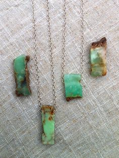 A gorgeous raw chrysoprase stone hangs freely from a sparkling sterling silver chain. Each stone is different - so you are truly getting a