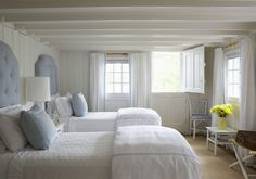Cape Cod pretty white with blue twin bed room