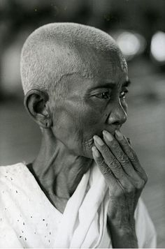 A Cambodian refugee woman ponders her future at Ban Kaeng camp in Thailand.  UNHCR/ R. Burrows/ 1982