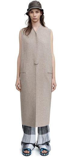 Fox doublé beige melange sleeveless coat with a custom d-ring closure #AcneStudios #Resort2015