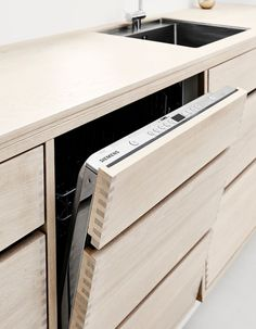 Danish bespoke kitchens - TRUE BESPOKE KITCHENS i could apply that wood aspect to the front off my washing machine leaving only the buttons and the screen unhidden or i could make a slide option the the wood hiding the buttons.