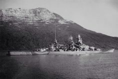 11 in battleship Scharnhorst in Norway, mid 1942 (her camouflage scheme had changed by the time of her loss in December the following year).  She saw more active service than any other German capital unit of WW2.  She was easily distinguished from Gneisenau (pictured nearby) by her mainmast, located aft whilst her sister's remained adjacent to her funnel.