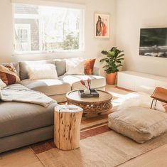 A living room in Boulder Colorado featuring West Elm s Haven Sectional Carved Wood Coffee Table and Natural Tree-Stump Side Table drsashafluss itskennywithrow Boho Living Room, Home And Living, Modern Living, Living Rooms, Earth Tone Living Room Decor, Small Living Room Sectional, Bohemian Living, Minimalist Living, Minimalist Decor