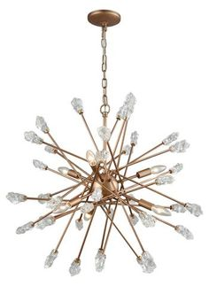 The Serendipity collection dazzles with a unique starburst design of randomly positioned spikes tipped with chiseled rock-shaped bubbled glass elements. This six-light chandelier's Matte Gold finish imbues a rich color tone into the glass endings. Sputnik Chandelier, Chandelier Ceiling Lights, Chandeliers, Elk Lighting, Pendant Lighting, Lighting Ideas, Metal Spikes, Candelabra Bulbs, Chandelier