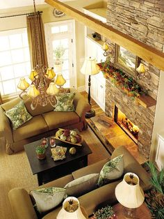 This is my idea of a perfect siting room.The family room is a warm gathering place for families on cold winter days. The texture of fabric-covered love seats contrasts nicely with the cultured stone of the fire place.
