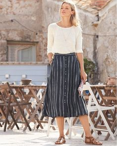 c8565881d2 Carefree and confident in linen, our Linen Midi Skirt features painted ikat  stripes that add