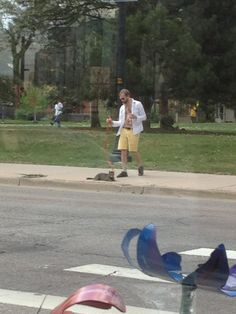 """ Guy holding Martini while walking his cat."