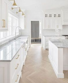 white kitchen design, cottage kitchen design with white shaker cabinets and gold hardware, wood herringbone floor in kitchen, modern farmhouse kitchen with stacked cabinets and gold sconces, white kitchen island with marble counter top White Kitchen Cabinets, Kitchen Cabinet Design, Kitchen White, Kitchen Cabinetry, Kitchen Countertops, Soapstone Kitchen, White Shaker Cabinets, Kitchen Floors, Kitchen Tops