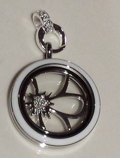 New Twist from Locket Origami Owl! Shown is:Twist locket White plate $34 Flower Window Plate $16 Silver Crystal Clasp $12 Spring Collection, Living Lockets www.meghangaska.origamiowl.com