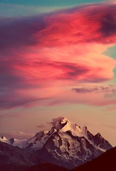 Colourful clouds over a snowy mountain