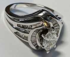T&Co 05228346  Total Diamond 2.12ct MARQUISE 0.90ct F/VS  BAGUETTE 1.12ct G/VS  Price: $24 000