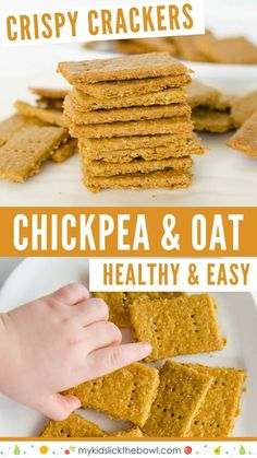 Chickpea oat crackers, stack of golden crackers and small childs hand reaching to grab one