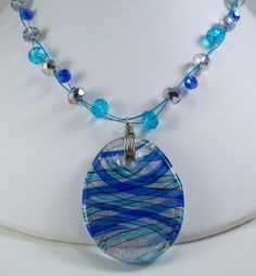 Glass Pendant necklace with different shapes of blue by Toonybird, $10.00